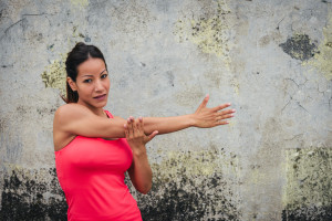 Woman stretching her shoulder